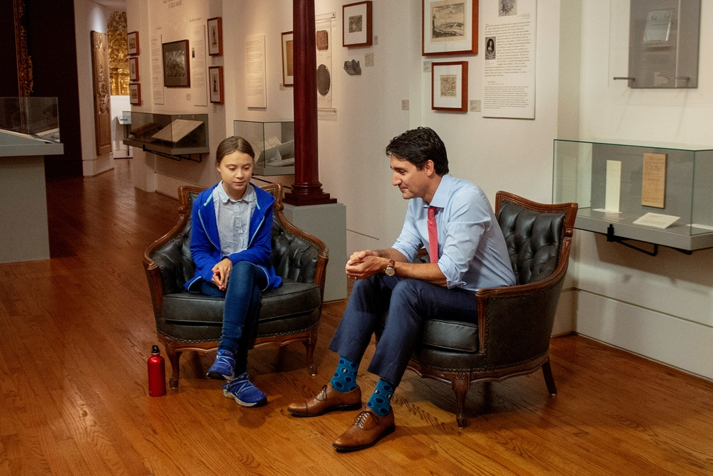 Canadian Prime Minister Justin Trudeau speaks Swedish environmental activist Greta Thunberg in Montreal on Friday, Sept. 27, 2019. (Ryan Remiorz/The Canadian Press via AP)