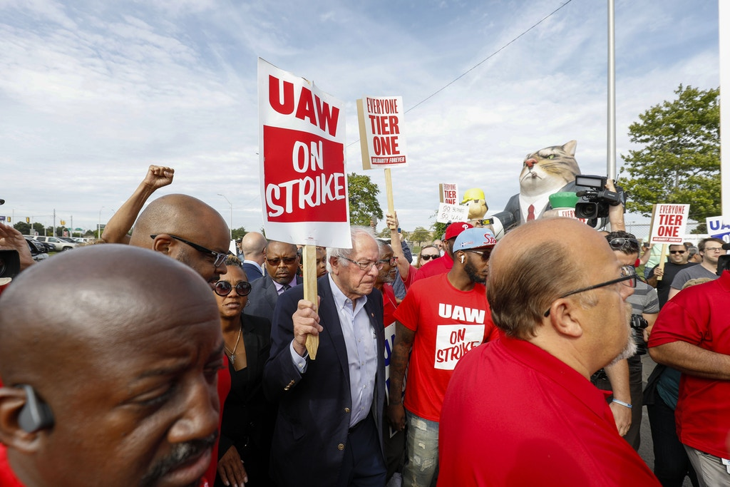 DETROIT, MI - SEPTEMBER 25: Democratic presidential candidate, Sen. Bernie Sanders (I-VT) walks the picket line with striking United Auto Workers union members as they picket at the General Motors Detroit-Hamtramck Assembly Plant on September 25, 2019 in Detroit, Michigan. The UAW called a strike against GM at midnight on September 15th, the union's first national strike since 2007. This is the union's longest national strike since 1970. (Photo by Bill Pugliano/Getty Images)