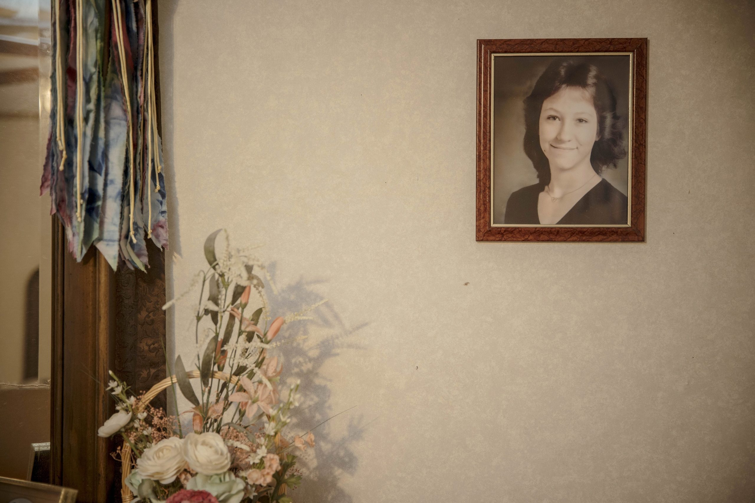 A photograph of Nancy Mueller hangs at the home of her mother, Earlene Peterson, in Hector, Ark., on Oct. 18, 2019. A white supremacist was convicted of murdering Mueller, her husband and her daughter, but the victims' family members, the prosecutor and the judge have all said the death sentence scheduled to be carried out in December  was too arbitrary to justify. (Andrea Morales/The New York Times)