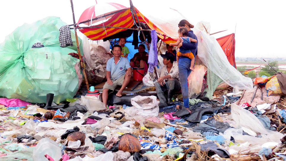 A Cambodian family living in a shelter on a garbage dump in a Phnom Penh suburb in 2015.