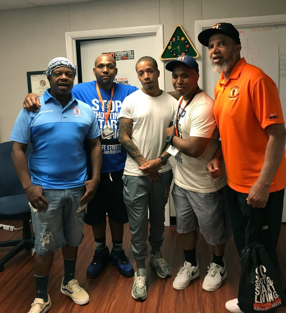 """Safe Streets workers, from left: """"Ice,"""" a Cherry Hill hospital responder; Dante Barksdale, outreach coordinator; """"Reds"""", another hospital responder; Elgin Maith, Director CHerry Hill Safe Streets; Denis Wise, former Director of Penn North Safe Streets."""