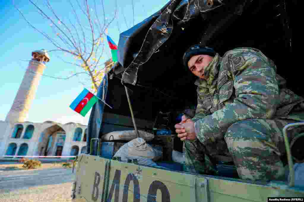 Azerbaijani soldiers in the town of Agdam on November 24