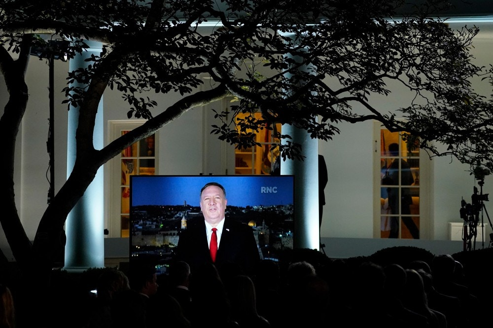A video of Secretary of State Mike Pompeo speaking during the Republican National Convention plays from the Rose Garden of the White House, Tuesday, Aug. 25, 2020, in Washington. (AP Photo/Evan Vucci)