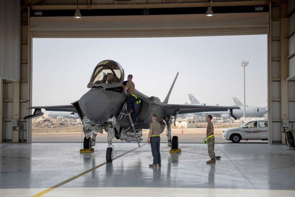 In this Aug. 5, 2019, photo released by the U.S. Air Force, an F-35 fighter jet pilot and crew prepare for a mission at Al-Dhafra Air Base in the United Arab Emirates. The Trump administration has formally notified Congress that it plans to sell 50 advanced F-35 fighter jets to the United Arab Emirates as part of a broader arms deal worth more than $23 billion. (Staff Sgt. Chris Thornbury/U.S. Air Force via AP)