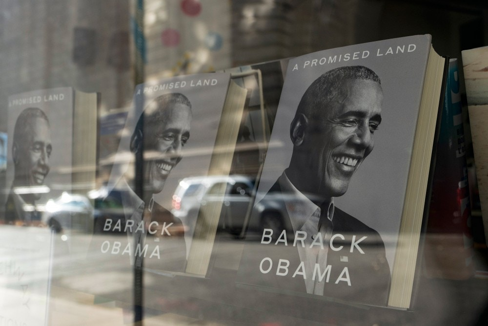 """""""A Promised Land"""" by former President Barack Obama is displayed in the window of a New York bookstore, Wednesday, Nov. 18, 2020. (AP Photo/Mark Lennihan)"""