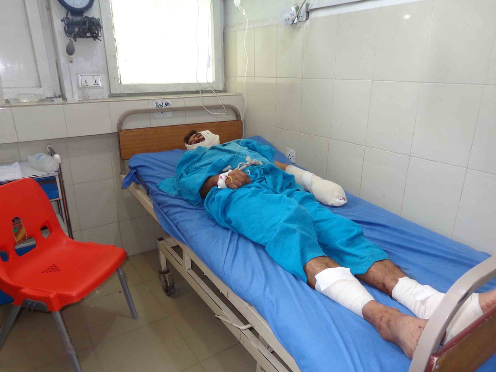 A wounded man lies on a stretcher at Jalalabad hospital after a suspected US drone strike killing at least 16 people in Nangarhar, Afghanistan on September 28, 2016.