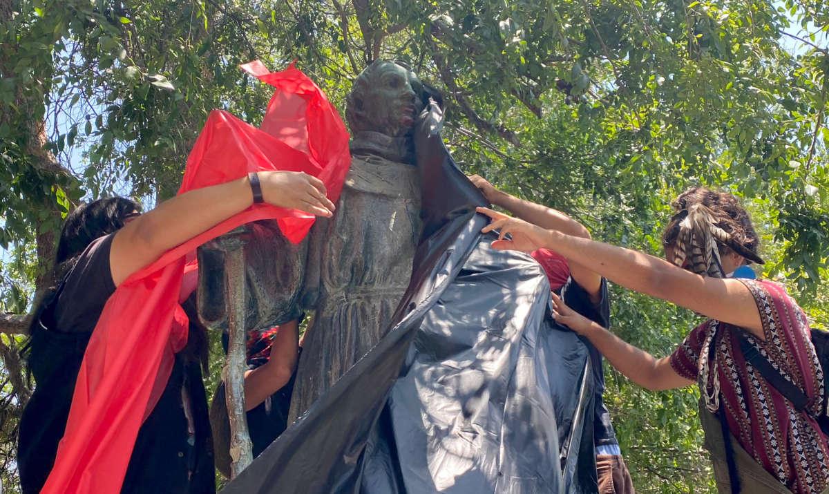 LaRazaUnida cover the Fray Junípero Serra Statue in protest at the Brand Park Memory Garden across from the San Fernando Mission in San Fernando on June 28, 2020.