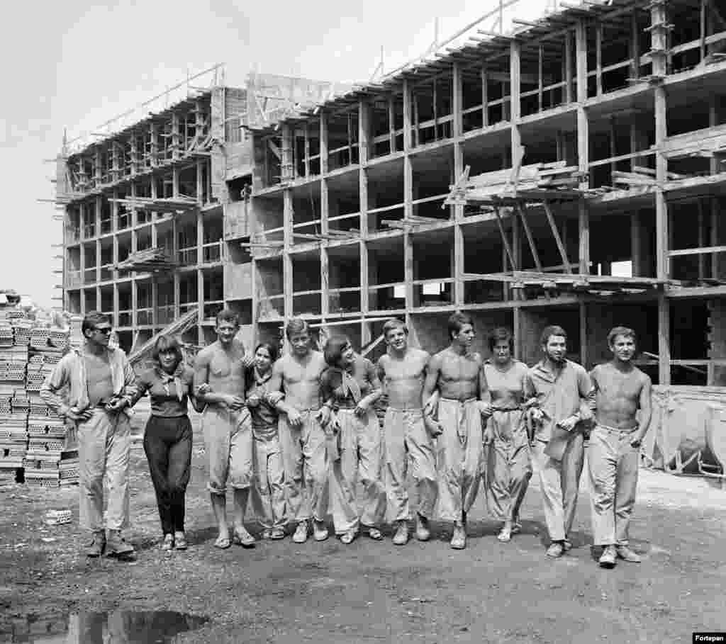 1969: Workers at a building site in summer. After several decades of socialism in Hungary, money for grand public projects began drying up.