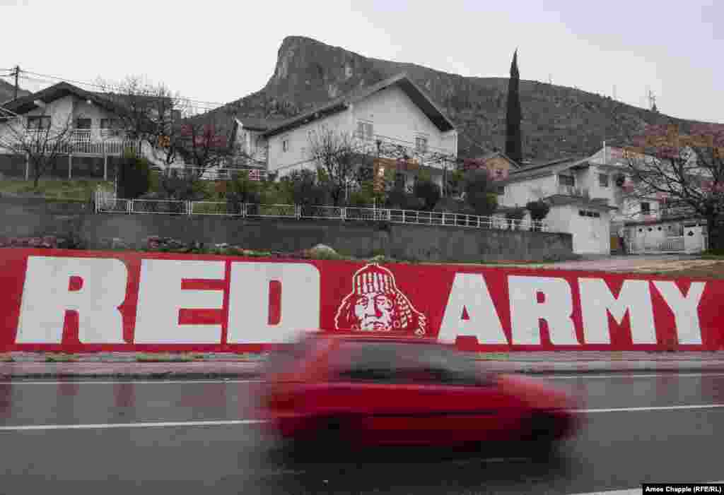 """One of several murals on the Bosniak side of Mostar to the """"Red Army"""" -- hard-core supporters of the mostly Bosniak Velez Mostar soccer team."""