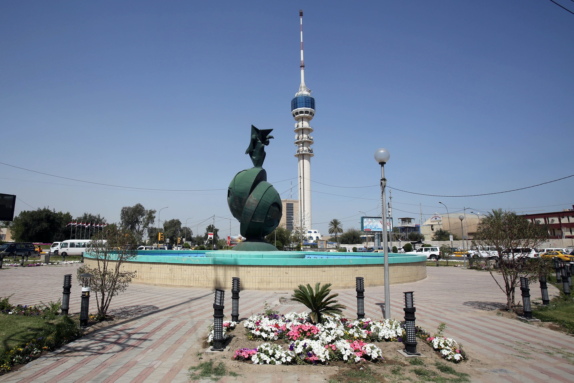 Spring flowers are planted in Nisoor Square, the site of a deadly shootout by Blackwater private security contractors in 2007, in Baghdad, Iraq, on April 15, 2015.
