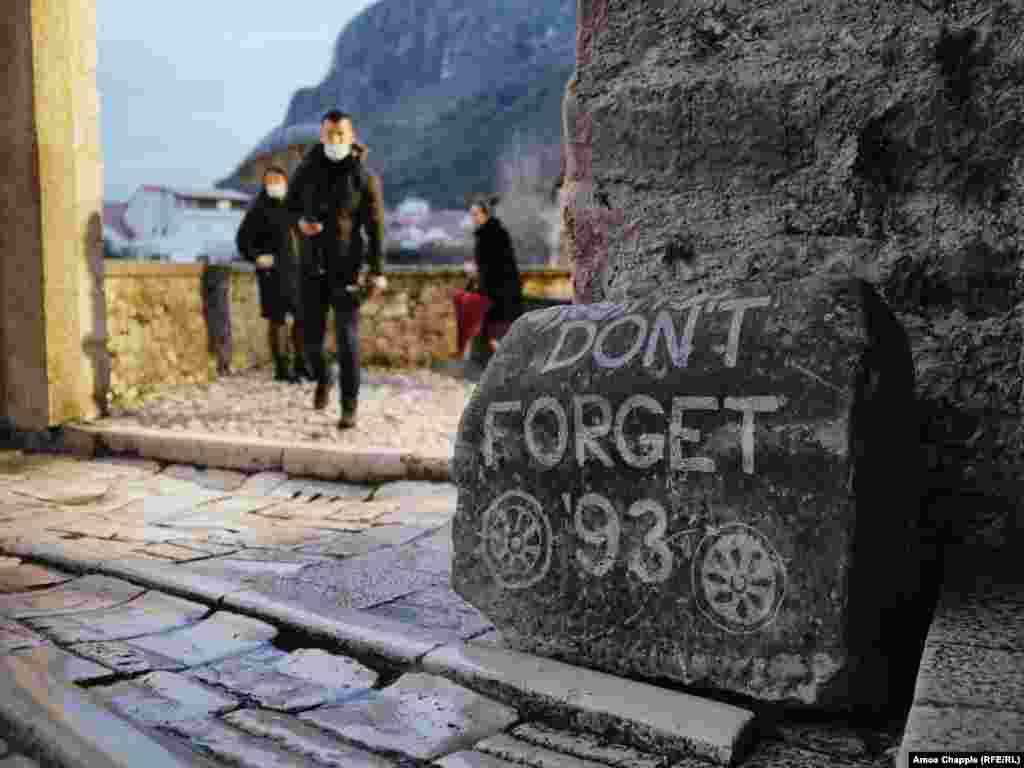 A stone at the entrance to Mostar's iconic Old Bridge references the year when the 16th-century Ottoman structure was destroyed by Croatian fighters. The bridge was rebuilt in the 2000s.