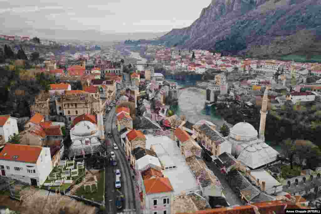 This is Mostar, a city in southern Bosnia famous for its stone bridge (center right) across the Neretva River.