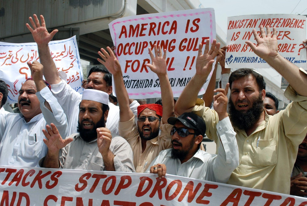Pakistani protesters belonging to United Citizen Action shout anti-US slogans during a protest in Multan on June 10, 2011 against the US drone attacks in Pakistani tribal areas. Thirteen attacks have been reported in Pakistan's tribal belt since US commandos found and killed Al-Qaeda founder, Osama bin Laden in the Pakistani garrison city of Abbottabad, before flying off with his body and burying it at sea. Washington has called Pakistan's semi-autonomous northwest tribal region the most dangerous place on earth and the global headquarters of Al-Qaeda, where Taliban and other Al-Qaeda-linked networks have carved out strongholds. AFP PHOTO/ S.S. MIRZA (Photo by S.S. MIRZA / AFP) (Photo by S.S. MIRZA/AFP via Getty Images)