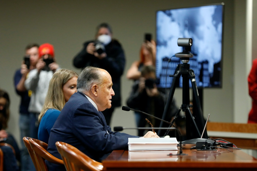 Rudy Giuliani, personal lawyer of US President Donald Trump, appears before the Michigan House Oversight Committee in Lansing, Michigan on December 2, 2020. - The president's attorneys, led by Rudy Giuliani, have made numerous allegations of election fraud. (Photo by JEFF KOWALSKY / AFP) (Photo by JEFF KOWALSKY/AFP via Getty Images)
