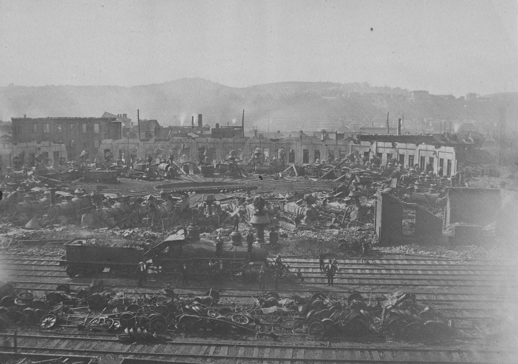 A view of the Great Railroad Strike destruction, on the 26th Street Pennsylvania Railroad Round House, July 1877.