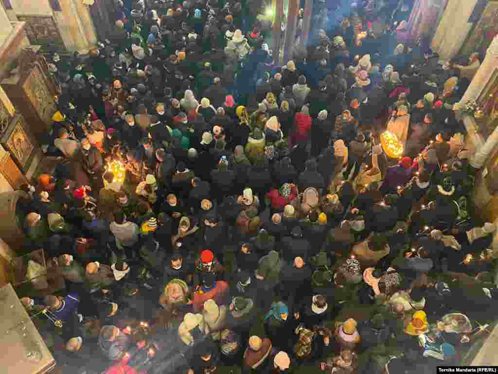 Crowds listen to the Christmas sermoninside Tbilisi's Holy Trinity Cathedral.