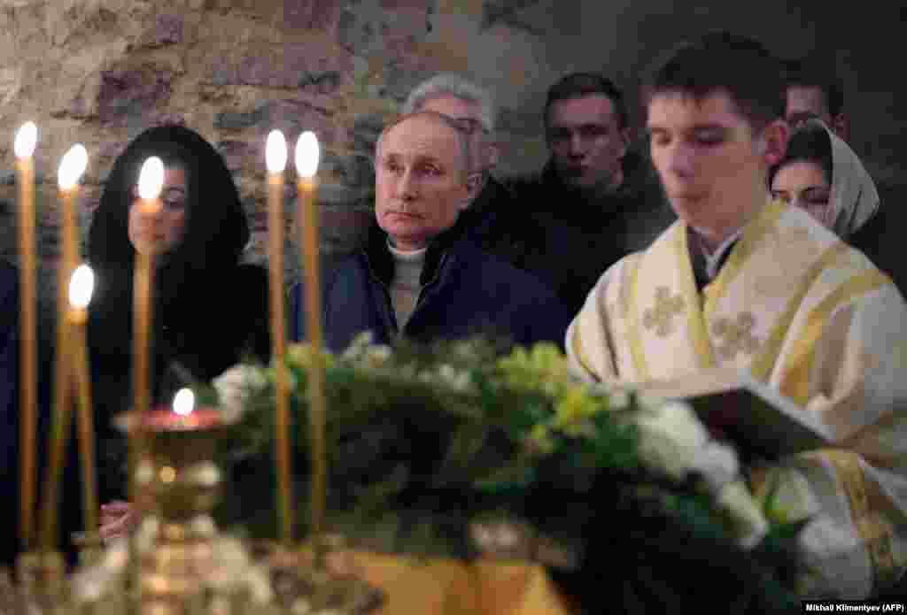 Russian President Vladimir Putin attends Orthodox Christmas mass at a small, 13th-century church near Veliky Novgorod.