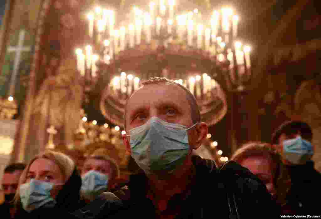Believers in face masks during Christmas mass at St. Volodymyr's Cathedral in Kyiv.