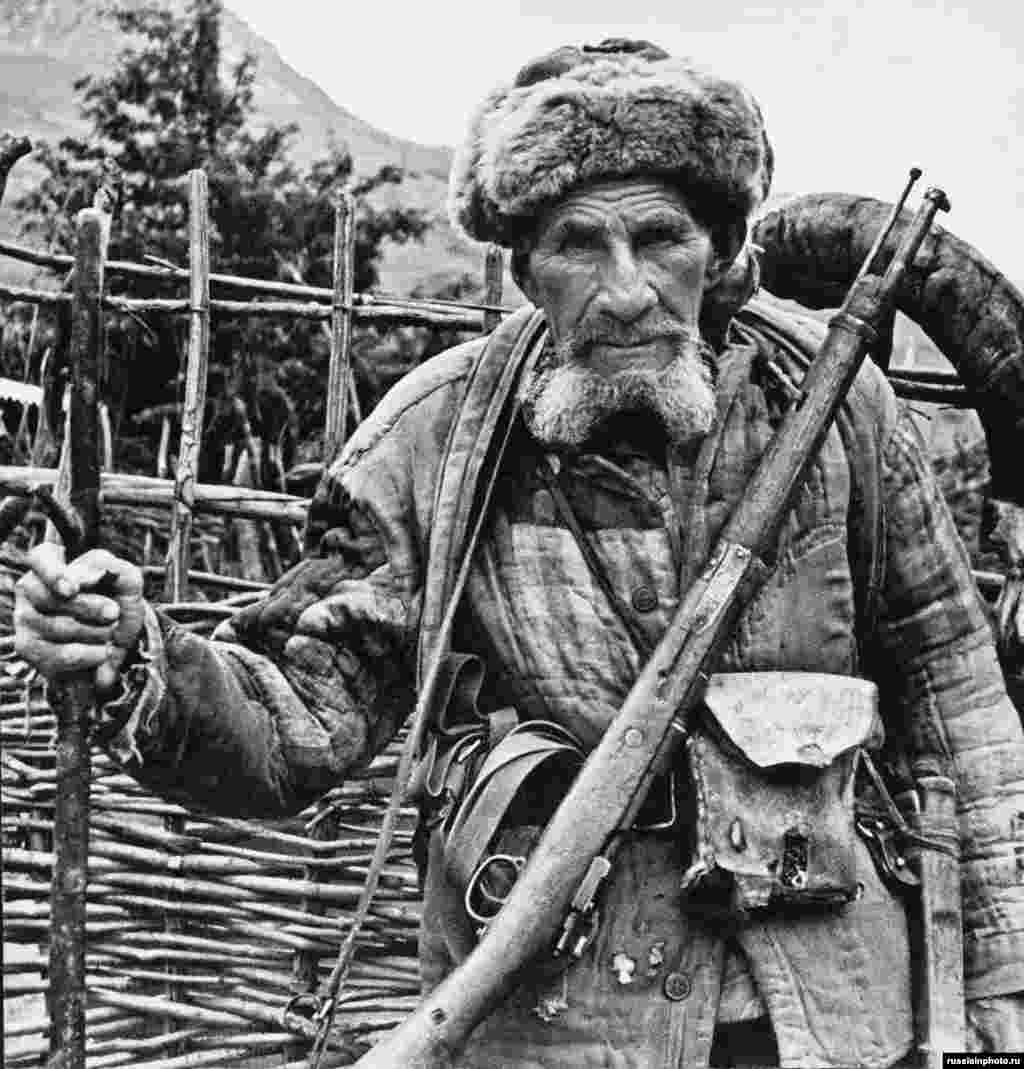 """A Ossetian hunter photographed in the 1970s. Ossetians are an Iranian ethnic group who speak a language related to Persian.  In 1989, the South Ossetian population of around 98,500 was two-thirds ethnic Ossetian and about one-third ethnic Georgian. An observer noted both Georgians and Ossetians """"are among the Soviet Union's most sociable people. They like to drag strangers by the arm to the hospitality of good food and impassioned toasts about freedom."""""""