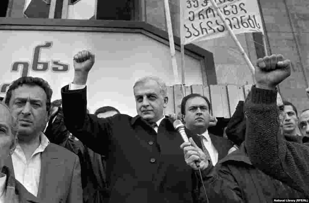 """Georgian President Zviad Gamsakhurdia (center) takes part in a Tbilisi rally in 1989.  As Georgia pushed for secession from the Soviet Union in the late 1980s, Zviad Gamsakhurdia -- an intellectual who pushed a hard-line, ethnic-nationalist message -- maneuvered into power. He was elected Georgian president in 1991 with nearly 90 percent of the vote. A philosopher reacted to Gamsakhurdia's """"Georgia for the Georgians"""" platform by declaring: """"if this is the choice of my people, then I'm against my people."""""""