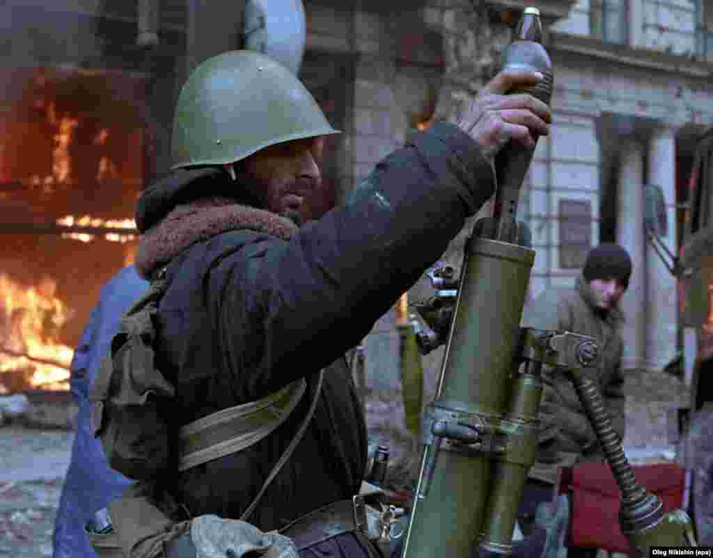 A militant opposing Zviad Gamsakhurdia loads a mortar in downtown Tbilisi during the coup against the Georgian president in December 1991. In January 1992, the long and bloody coup also known as the Tbilisi War did, indeed, topple Gamsakhurdia.