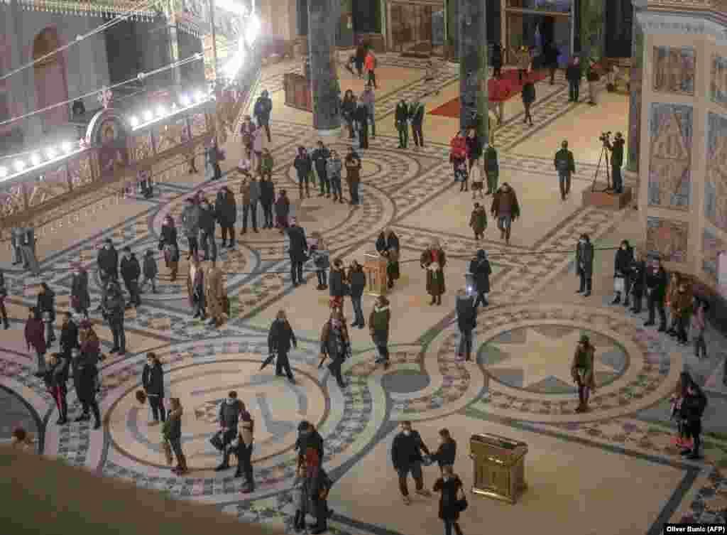 Orthodox Christians maintain social distancing inside Belgrade's St. Sava Church before the Christmas mass.