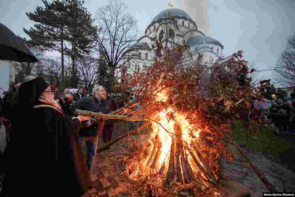 Christians burn oak branches in front of St. Sava Cathedral in Belgrade on January 6. The tradition of burning oak is believed to predate Christianity but is now a central part of Christmas celebrations in much of the Balkans.