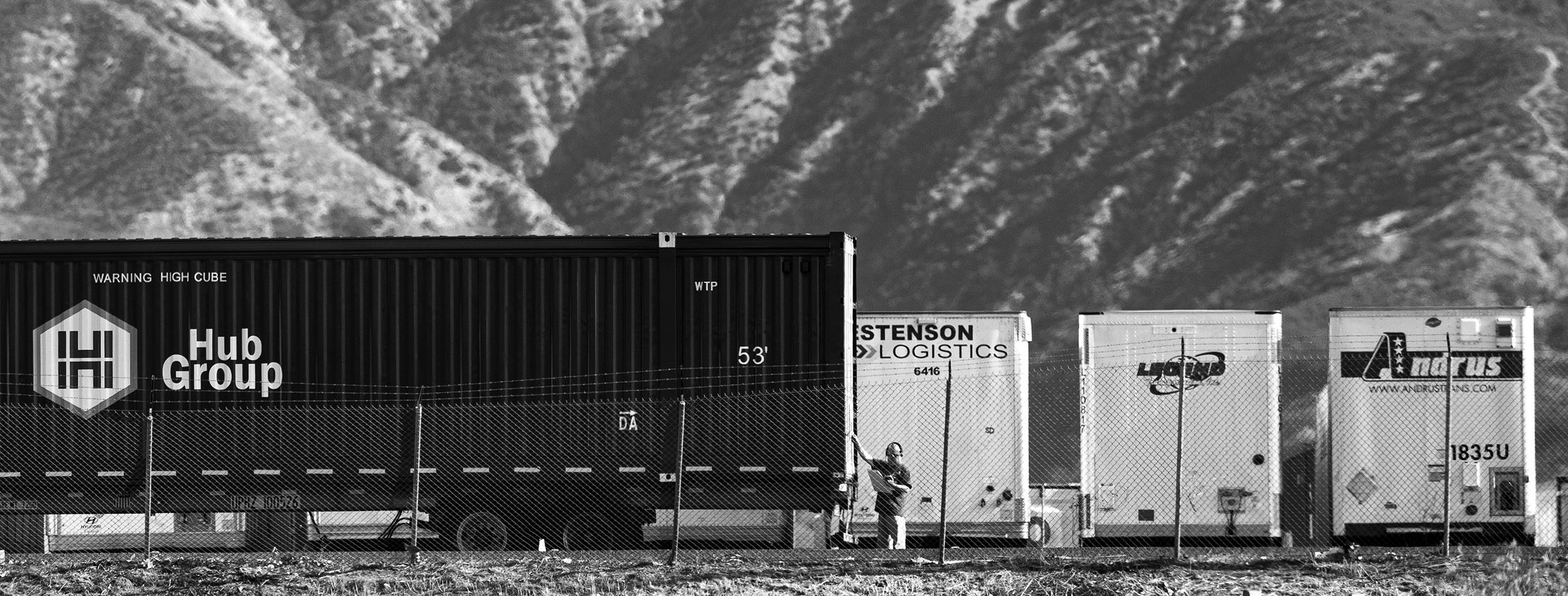 A lone trucker at work. San Bernardino has long been a transportation/distribution hub for the west coast of the United States. Trains, trucks, airplanes all converge there to distribute goods creating a heavy pollution burden on the area. In addition, much of the pollution from the LA/Orange County basin gets trapped there by converging mountain ranges as daily ocean winds push pollutants inland.