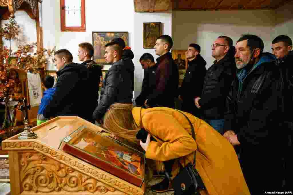 Ethnic Serbs in Kosovo attend mass in the village of Gusterica.