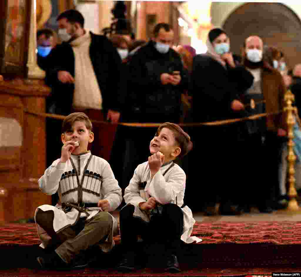 Boys in traditional clothing inside Tbilisi's Holy Trinity Cathedral as Georgians mark Orthodox Christmas early in the morning of January 7.