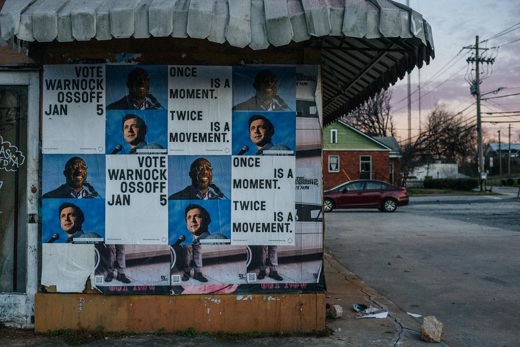 U.S. Senate campaign signs for Democratic candidates Jon Ossoff and the Rev. Raphael Warnock are shown on January 4, 2021 in Atlanta, Georgia.