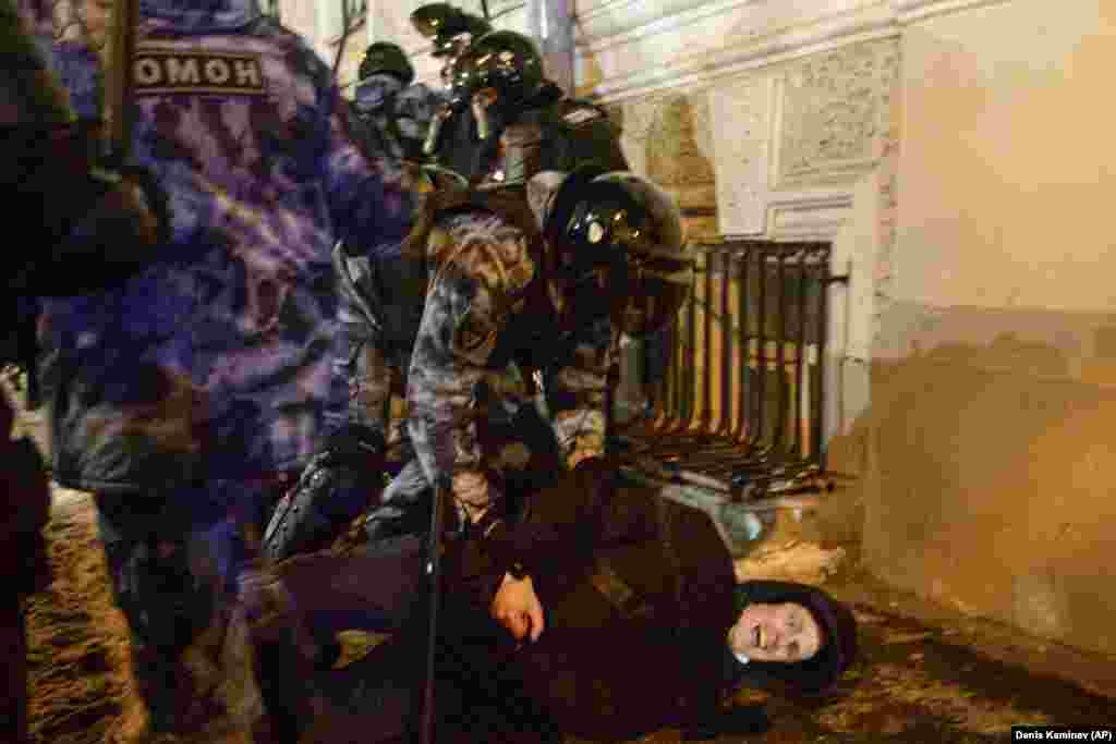 Police violently detain a man on Red Square in Moscow.
