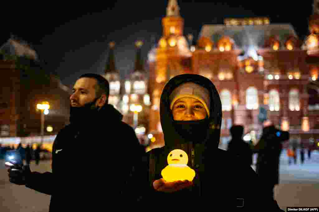 A woman poses with a glowing plastic duck near Red Square in Moscow on February 14. The duck is a reference to allegations that former Prime Minister (and one-term President) Dmitry Medvedev has a luxury property with a private lake and a shelter for waterfowl.