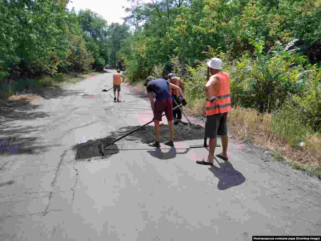 A work crew smoothing out a road in Novhorodske.  Shevchenko says locals' hopes are high that the anticipated name change will boost the fortunes of her beloved hometown.