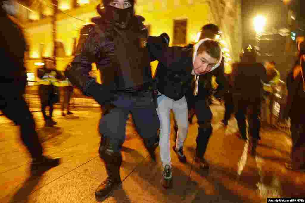 Police detain a man in St. Petersburg.