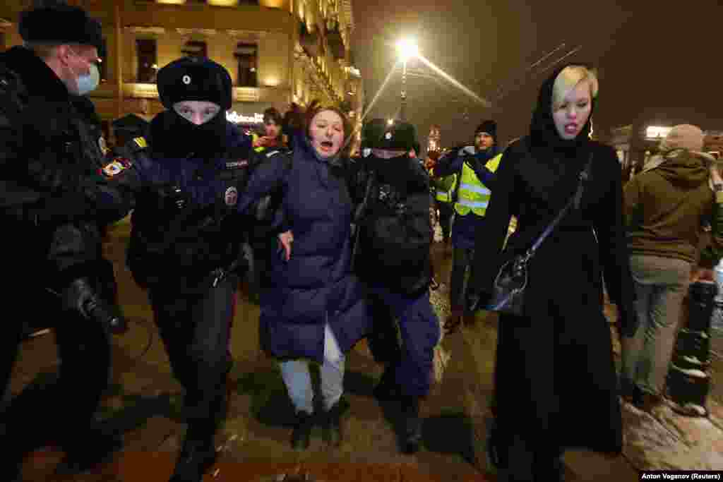 A woman is detained in St. Petersburg on February 2.