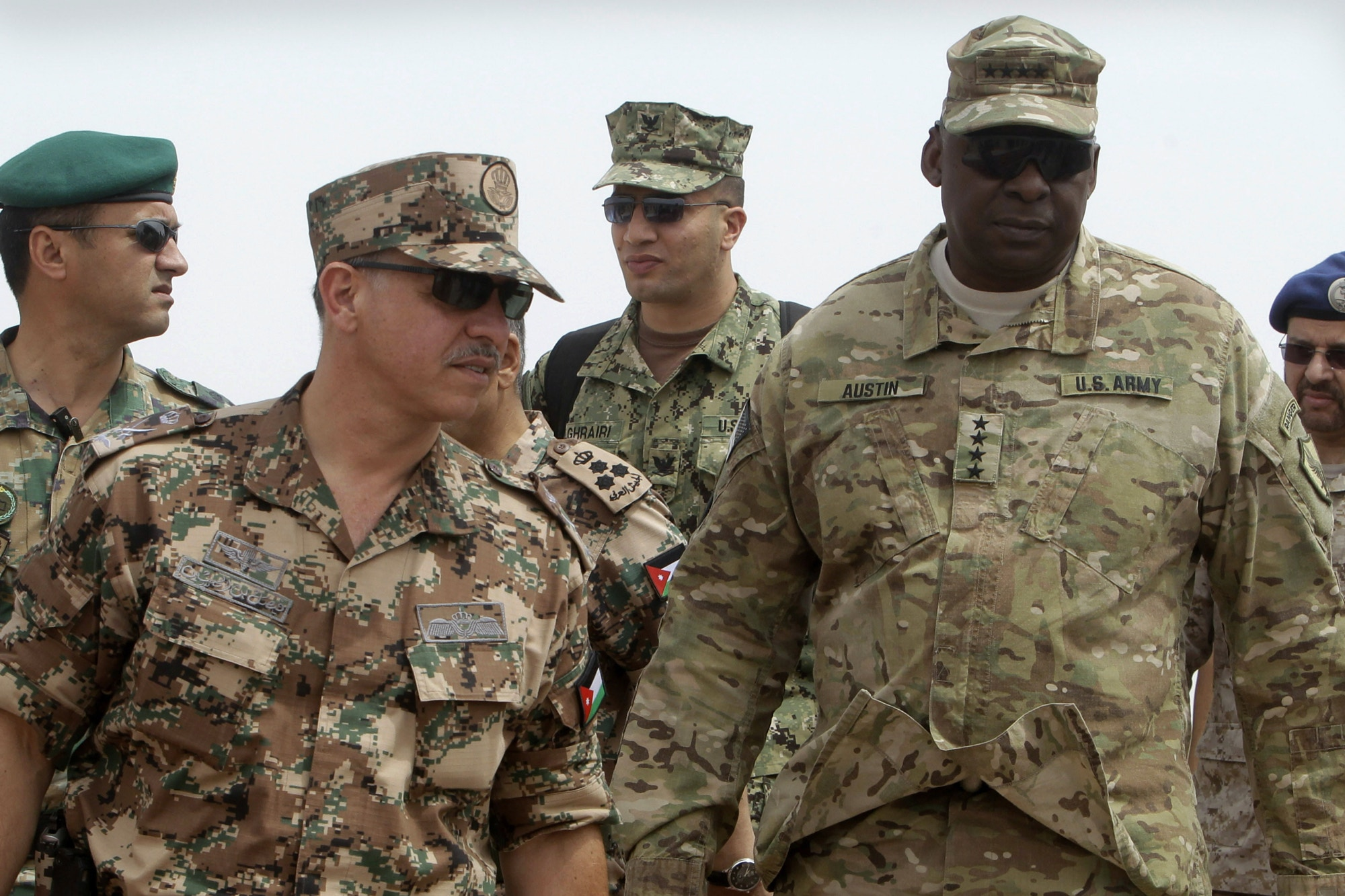 Jordanian Prince Faisal Bin al Hussein, left, and U.S. soldiers inspect 18-nation military exercises in a field near the border with Saudi Arabia, in Mudawara, 280 kilometers south of Amman, Jordan, on May 18, 2015