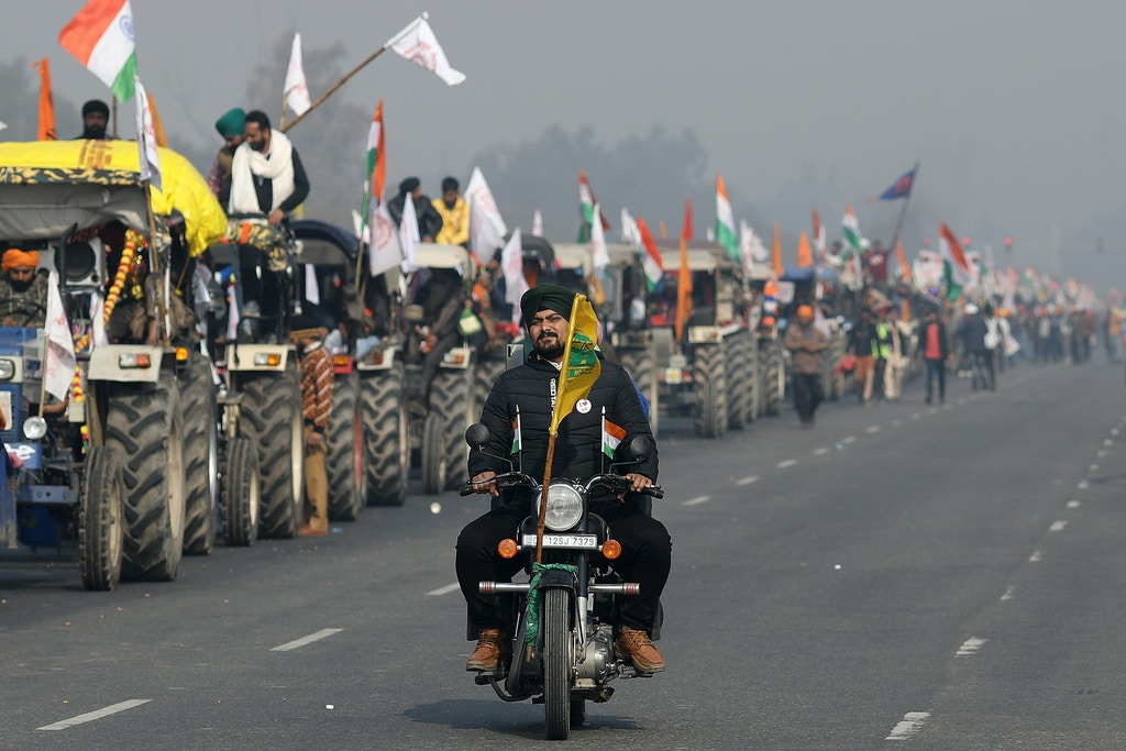 Farmers protest during a tractor rally near the Singhu border crossing in Delhi, India, on Tuesday, Jan. 26, 2021. Thousands of Indian farmers on tractors entered New Delhi as the country marked its Republic Day, escalating protests against new agricultural laws passed by Prime MinisterNarendra Modi's government. Photographer: Anindito Mukherjee/Bloomberg via Getty Images