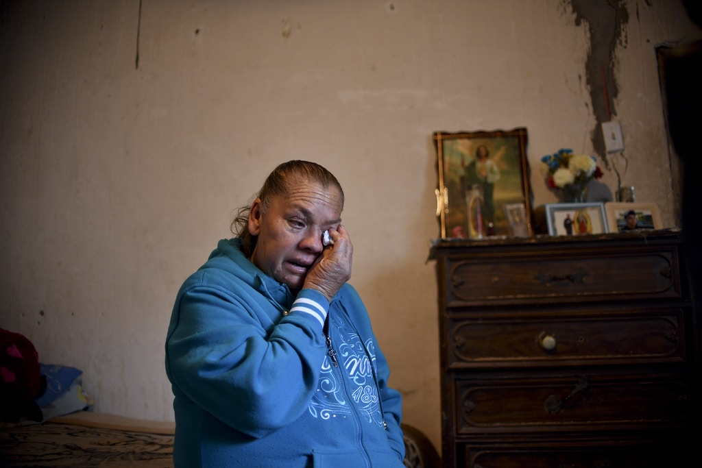 Maria Guadalupe Guereca, 60, cries while remembering her murdered son Sergio Hernandez, during an interview with AFP at her house in Ciudad Juarez, Chihuahua, Mexico, on February 18, 2017. The shooting occurred June 7, 2010 while Sergio Hernandez was spending time with three friends on the banks of the Rio Grande, which separates Ciudad Juarez in Mexico from El Paso in Texas, US. Sergio was shot dead at 15 by police officer Jesus Mesa. This would have been another tale of tragic and banal violence, had the victim not been in Mexico and the perpetrator in the United States. / AFP / Yuri CORTEZ        (Photo credit should read YURI CORTEZ/AFP via Getty Images)