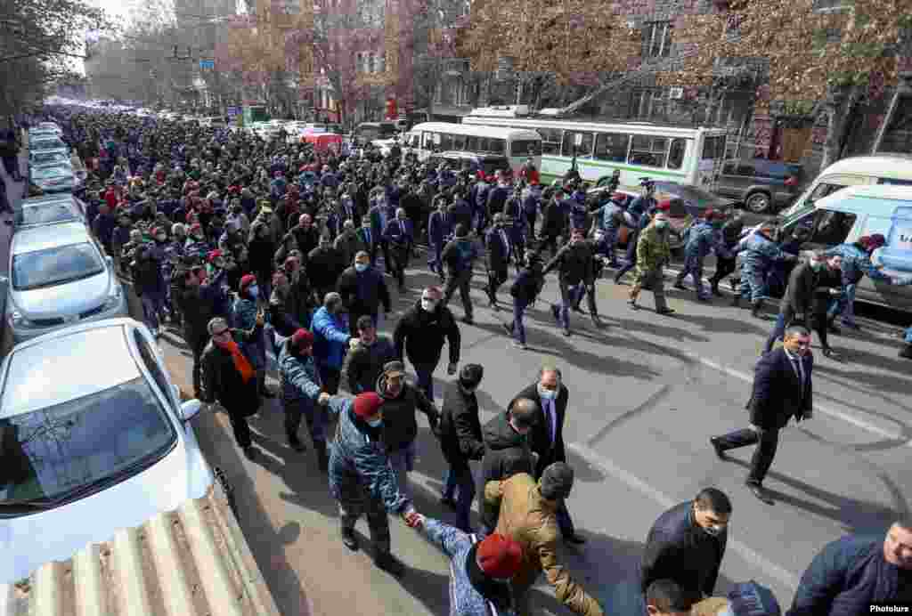 Pashinian (center left, holding a black loudspeaker) heads a protest march through Yerevan. He called on his supporters to meet in Yerevan's main Republic Square at 4 p.m. local time.
