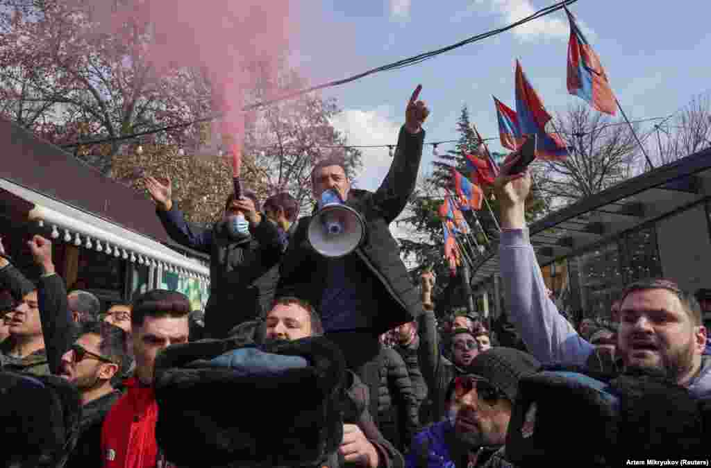 Protesters opposed to Pashinian shout slogans in central Yerevan. A February 25 letter signed by Armenian military leaders called for the prime minister's resignation. The letter came a day after Pashinian fired a top military official.