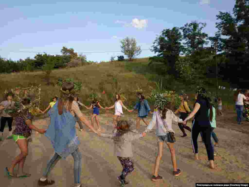Young locals dance during an Ivan Kupala festival in Novhorodske.  The Facebook page keeps locals up to speed on pothole repairs, public celebrations, and the minutiae of municipal spending.
