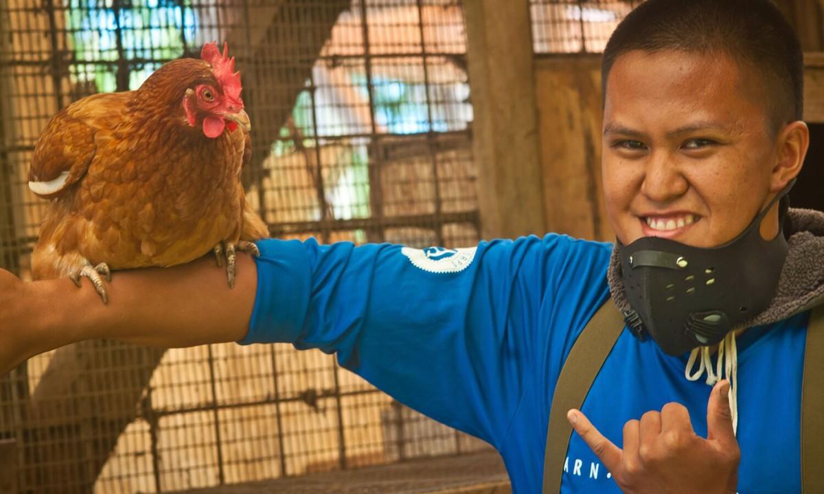 Former member of the Ho'okahua Ai Youth Mentorship Program and current farm assistant Jamiel Ventura. (Photo: Malia Welch)