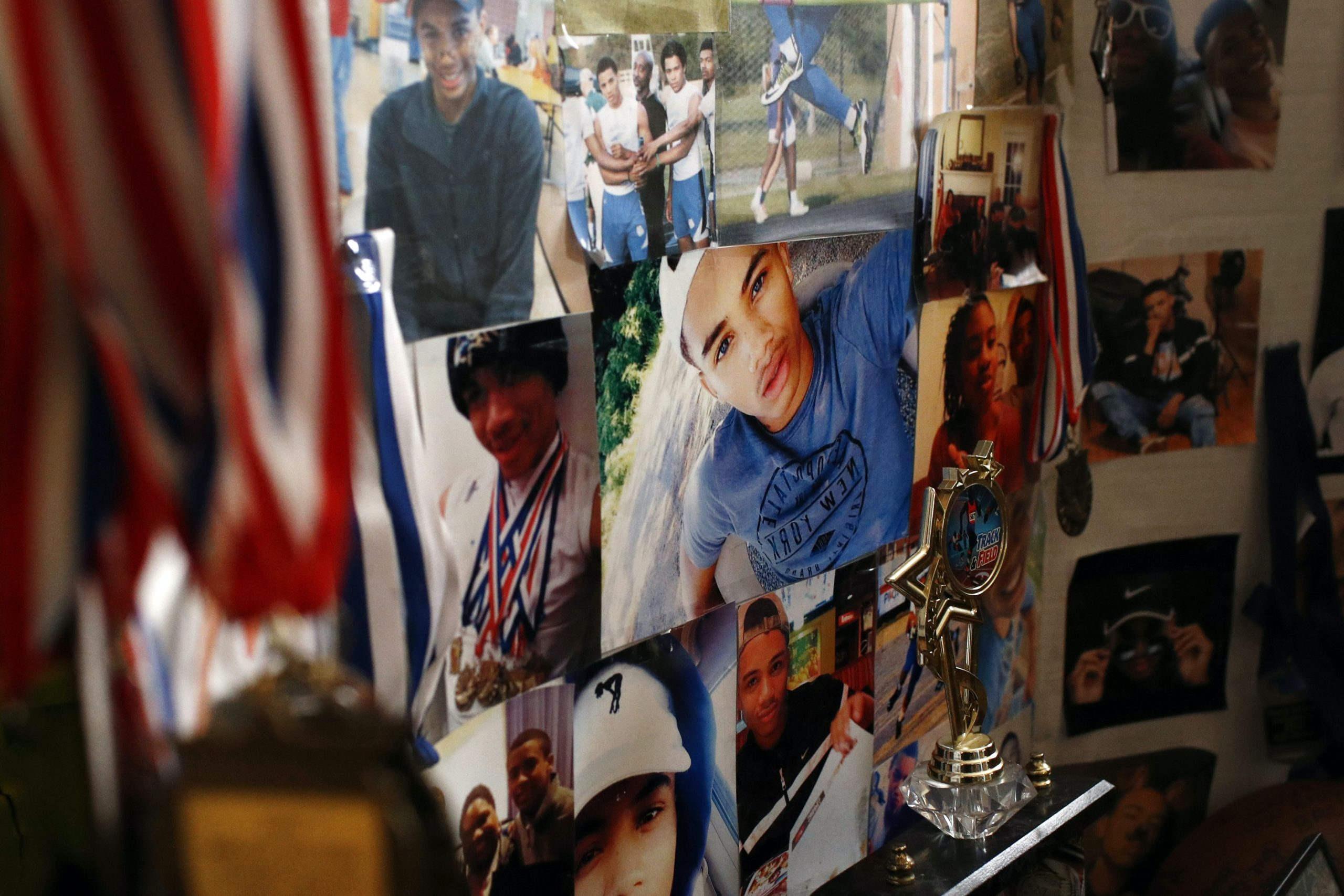 In this Jan. 28, 2019, photo, pictures of Anton Black decorate a collage in his family's home in Greensboro, Md. Black, 19, died after a struggle with three officers and a civilian outside the home in September 2018. (AP Photo/Patrick Semansky)
